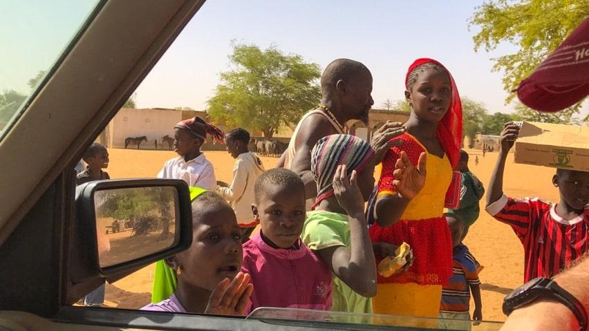People in Senegal greet overlanders